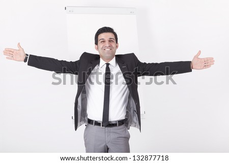 portrait of a gesticulating executive during business meeting and coaching. Studio shot with a flipchart on a white background.