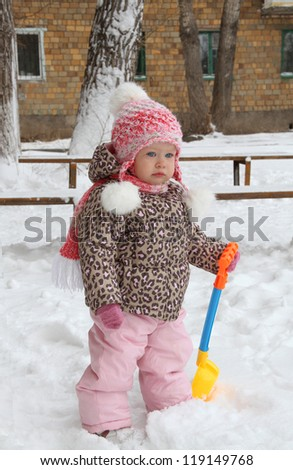 Portrait of a Girl and a half years for a walk in winter - stock photo