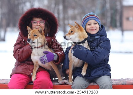 portrait of a girl and puppy winter - stock photo