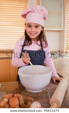 Portrait of a girl baking in a kitchen - stock photo