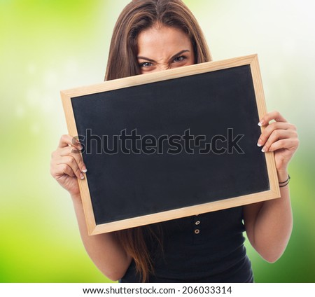 portrait of a girl behind of a chalkboard - stock photo