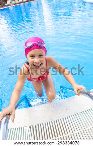 portrait of a girl coming out of the pool - stock photo