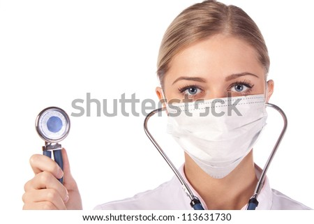 Portrait of a girl doctor in a mask. phonendoscope - stock photo