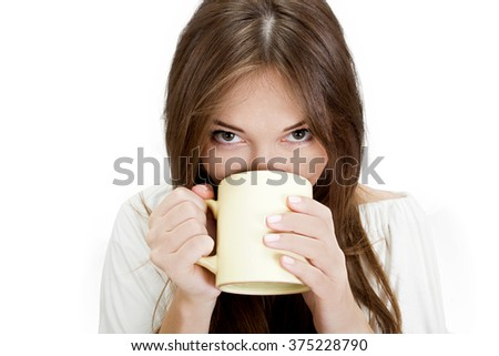 Portrait of a girl drinking from cup
