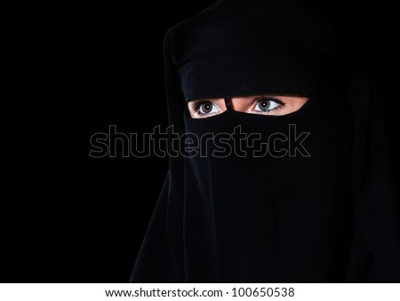 Portrait of a girl east on a black background - stock photo