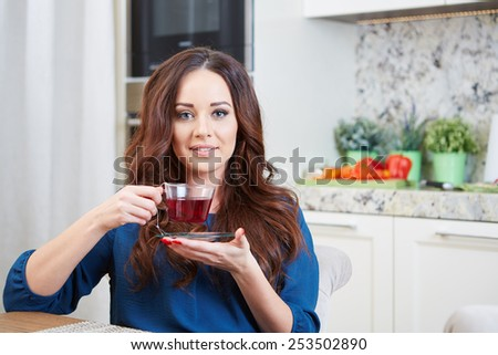 Portrait of a girl eating breakfast in an apartment - stock photo