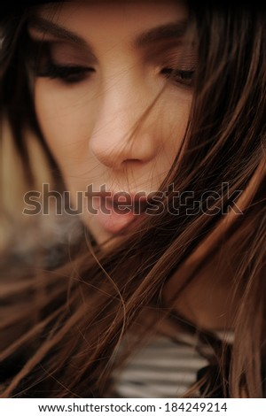 Portrait of a girl exhaled smoke