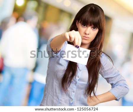 Portrait Of A Girl Holding And Angry, Outdoor - stock photo