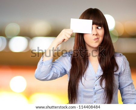 Portrait Of A Girl Holding Paper And Making Face, Outdoor - stock photo