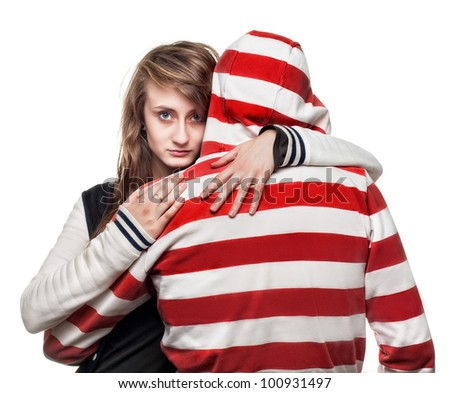 Portrait of a girl hugging a young man in the hood