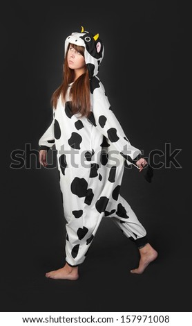 portrait of a girl in a cow costume - stock photo
