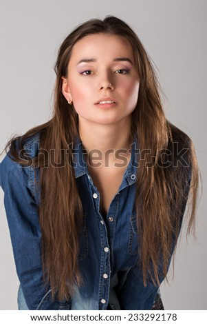 portrait of a girl in a denim jacket - stock photo