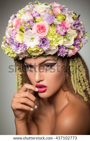 Portrait of a girl in a hat of flowers