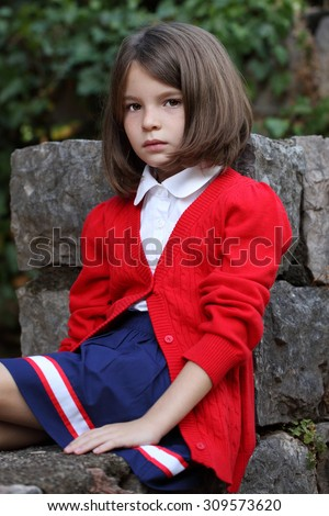 Portrait of a girl in a school uniform. The beautiful schoolgirl. English education. American schoolgirl. Stylish uniforms - stock photo