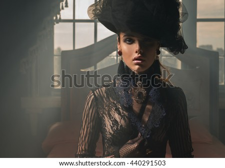 Portrait of a girl in a vintage hat and jewel chest
