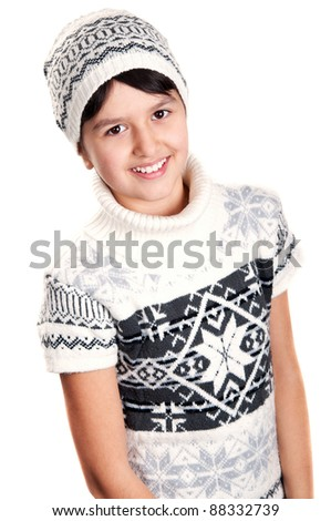 portrait of a girl in a winter sweater and cap isolated on a white background