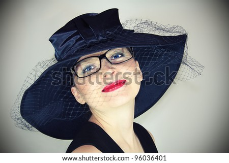 portrait of a girl in glasses with blue retro glasses - stock photo