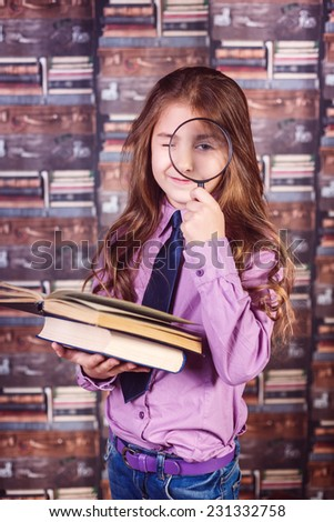 portrait of a  girl in library with books - stock photo
