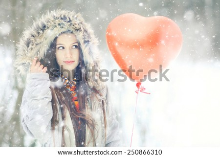 portrait of a girl in love with balloon winter day of St. Valentine - stock photo