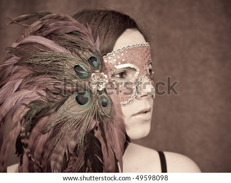 Portrait of a Girl in Masquerade Mask - stock photo