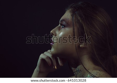 Portrait of a girl in profile on a black background
