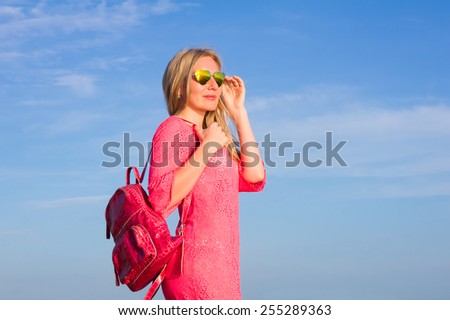 portrait of a girl in sunglasses at sea