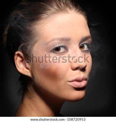 portrait of a girl in tobacco smoke