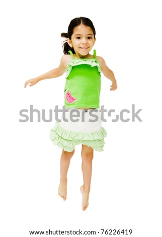 Portrait of a girl jumping and smiling isolated over white - stock photo