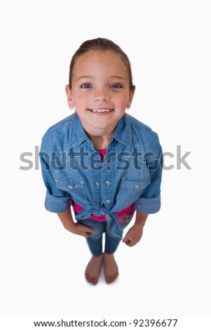 Portrait of a girl looking up against a white background