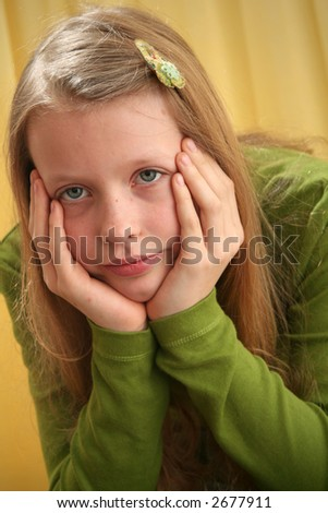 Portrait of a girl on a yellow background - stock photo