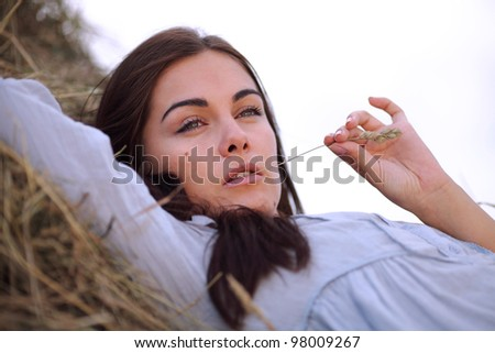 portrait of a girl on stack of hay