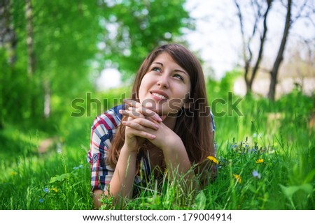 portrait of a girl on the grass in spring