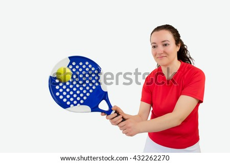 portrait of a  girl paddle tennis player standing and swatting the ball - stock photo