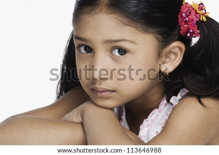 Portrait of a girl resting her face on her hands - stock photo