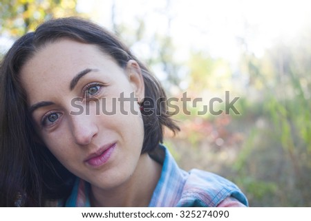 Portrait of a girl resting on the nature.
