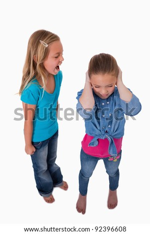 Portrait of a girl screaming at her friend against a white background - stock photo