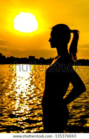 Portrait Of A Girl Silhouette With Sunset Background