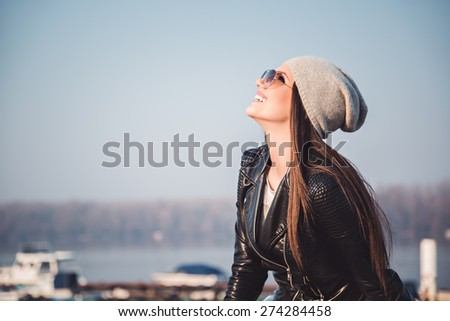 Portrait of a girl smiling and looking up - stock photo