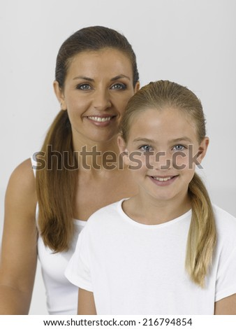 Portrait of a girl smiling with her mother