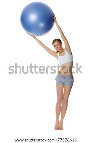 Portrait of a girl training with gymnastic ball - stock photo