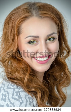 portrait of a girl. vignetting. professional makeup and hairstyle.  smiling
