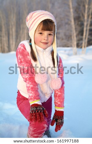 portrait of a girl walking around outdoors in the winter - stock photo