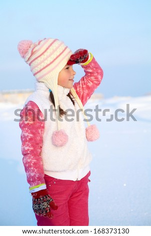 portrait of a girl walking around outdoors in the winter, looking into the distance - stock photo