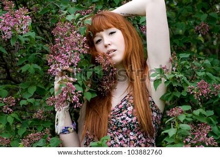 Portrait of a girl walking in park in summer - stock photo