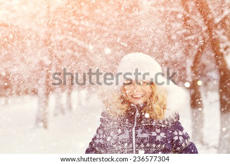 portrait of a girl walking in the winter outdoors. playing with snow. children outdoor - stock photo