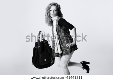 portrait of a girl with a bag - stock photo