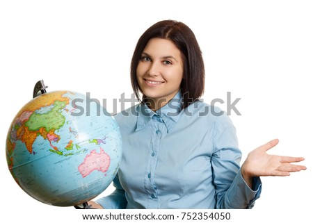 Portrait of a girl with a globe. Female teenage student posing with globe against white background