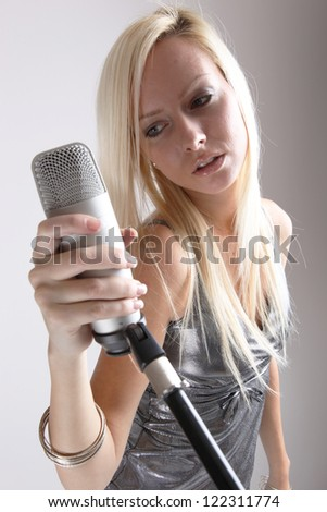 portrait of a girl with a microphone - stock photo