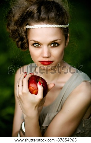 portrait of a girl with an apple in hand - stock photo