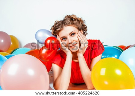 portrait of a girl with balloons smiling - stock photo